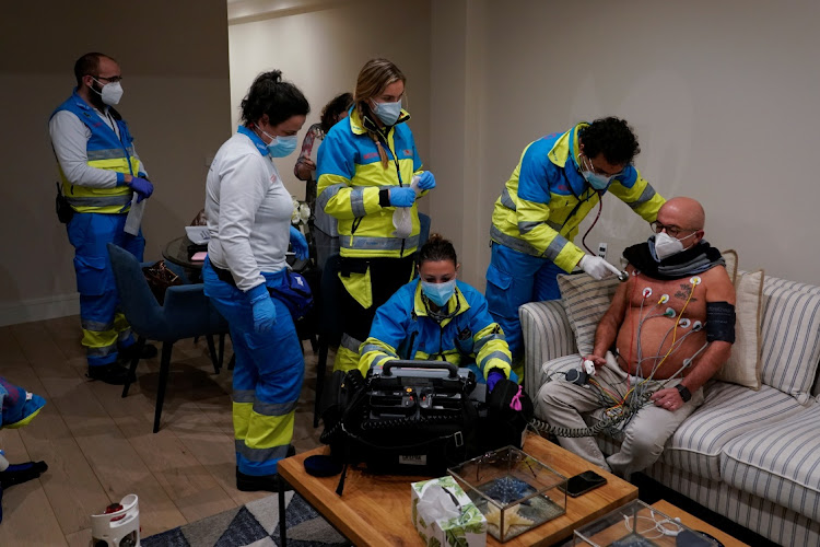 Dr Navid Behzadi Koochani and his team from the Madrid Emergency Service treat a patient in his home in Madrid, Spain.