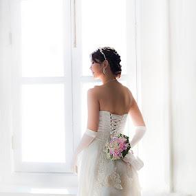 by Lie Oktevianus - Wedding Bride