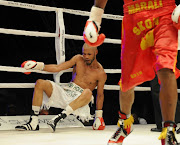 Ali Funeka (green and white trunks) during the World Boxing Federation Light Welterweight title bout against Zolani Marali at Monte Casino on November 19 2011 in Johannesburg.