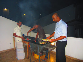 Photo: Barbeque on the Roof! That's our gardener, assistant program manager and the head honcho program manager. (Kandy)