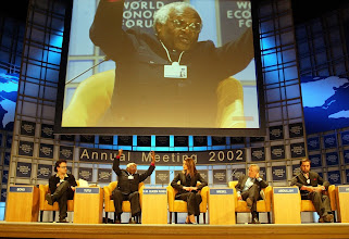 "Photo: NEW YORK,31JAN02 Desmond M. Tutu (2nd from left), Archbishop Emeritus of South Africa, raises his hands while making a statement on the panel during a session of the 32nd Annual Meeting of the World Economic Forum at the Waldorf-Astoria hotel In New York January 31, 2002. The session was simply titled ""For Hope"". 