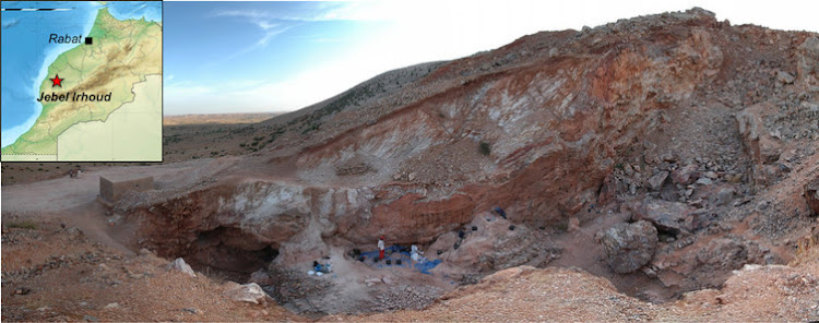 View looking south of the Jebel Irhoud (Morocco) site. The remaining deposits and several people excavating them are visible in the centre. At the time the site was occupied by early hominins, it would have been a cave, but the covering rock and much sediment were removed by work at the site in the 1960s. Picture: SHANNON MCPHERRON, MPI EVA LEIPZIG