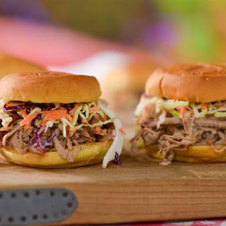Homemade Pulled Pork Sandwich with Coleslaw and BBQ Sauce.