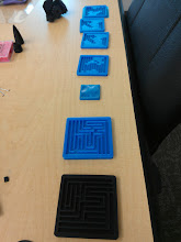 """Photo: Several generations of maze. There is one more the size of the smallest with an embossed """"UK"""" on the back that prints in about 20 minutes one-off (no optimization attempts yet) that will likely be the E-Day giveaway."""