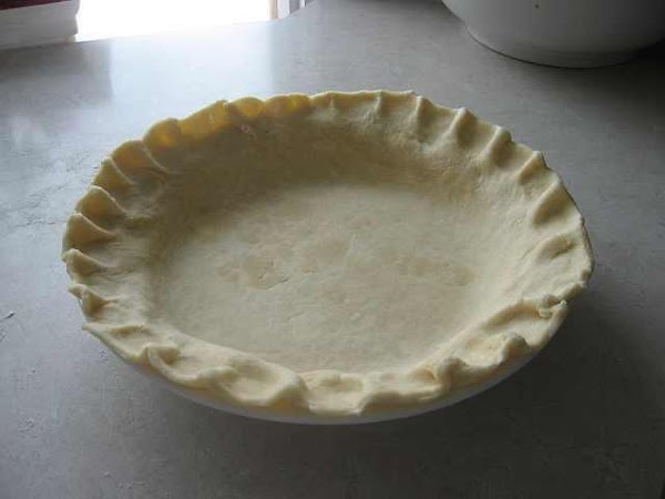 Preheat oven to 450°F. Place pie crust in ungreased pie pan.
