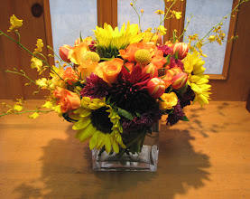Photo: Square Glass Sunflowers Roses Orchids $45.00.