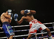 Zolani Tete (R) right hooks Omar Andres Narvaez during the WBO Bantamweight Championship of the World title fight at SSE Arena Belfast.