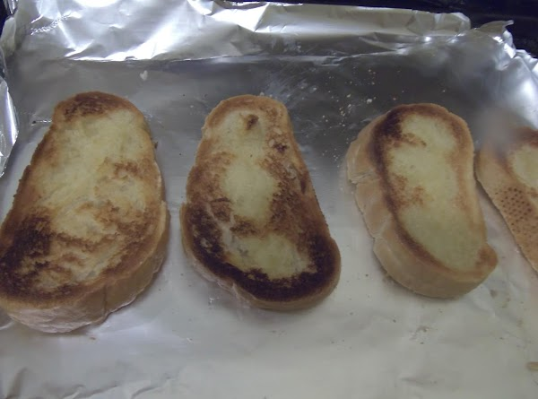 Toast 4 slices of the bread til lightly browned, It is going under the...