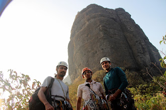 Photo: Richie Kher, Ajit Bobhate, and Sunny Jamshedji, geared up and confident, yet dwarfed by Bhatoba and the gash they were just about to climb! (Courtesy Ketan Vaidya)