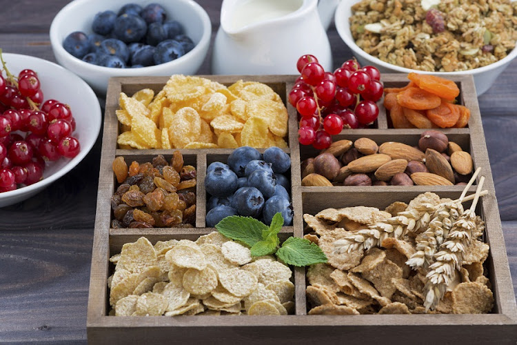 Breakfast cereal and other ingredients in a wooden box. Picture: ISTOCK