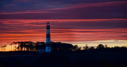 Photo: Lighthouse in the sunset  And be sure to join us for our show Monday night (see your time on the event page at http://goo.gl/6v2aV ) to talk all about backing up your photos. It should be a good show full of great information!
