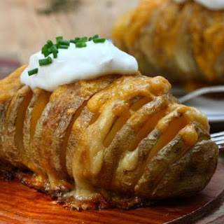 Baked Potatoes With Cheese.