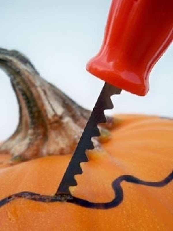 carve an opening at the top of your pumpkin and save the top. Scoop...