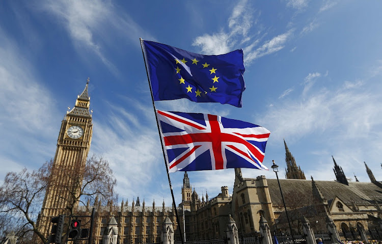 EU and Union flags fly above Parliament Square in central London, Britain. File photo: REUTERS