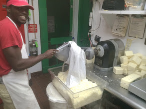 Photo: Michael making our custom Pizza cheese blend of 50% mozzarella AND 50% Wisconsin white cheddar
