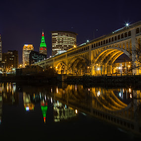 Cleveland at Christmas by David Pilasky - Buildings & Architecture Bridges & Suspended Structures ( water, skyline, cuyahoga river, detroit superior bridge, christmas, reflections, night, bridge, river, cleveland, nightscape )