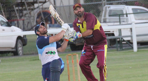 Town Heat opener Lachlan Cameron smashes one of his 10 sixes on Friday night in his side's win, on his way to an unbeaten 149 from 70 balls. Watching on is Country Thunder wicketkeeper and captain Mick Dowdell.