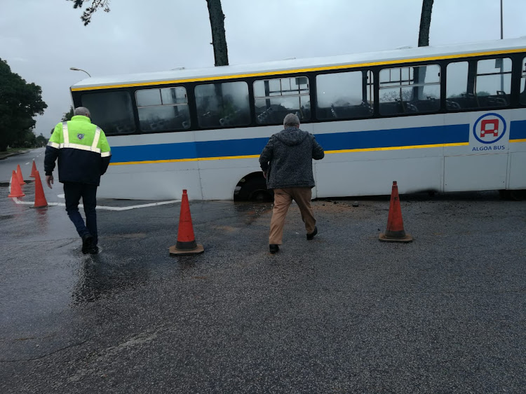 A bus got stuck in a large pothole in Lorraine, Port Elizabeth, on Wednesday morning.