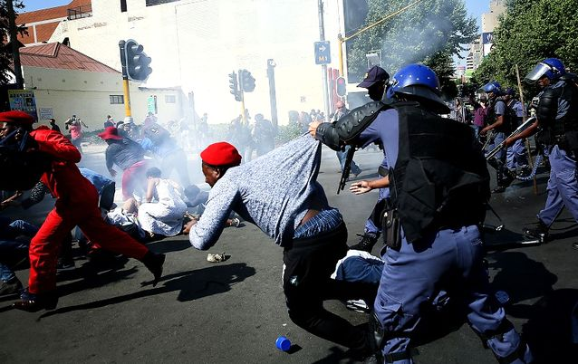 Police detain a man during student protests in Johannesburg. Picture: ALON SKUY/THE TIMES
