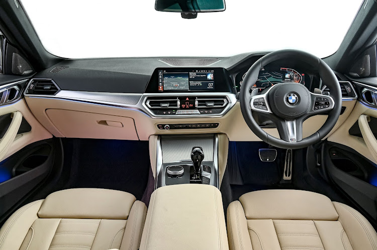 The interior is supmtuous and digitised. Rear seat has good legroom but taller folk will be a little squashed under the coupe roof. Picture: SUPPLIED