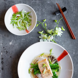 Sesame crusted trout on rice noodles with an Asian broth