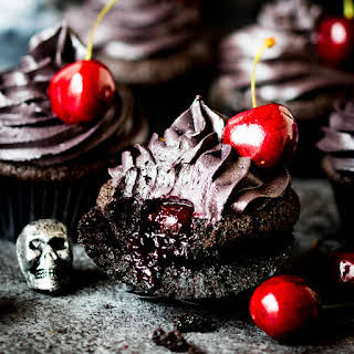 Halloween Black Cupcakes With Cherry Filling.