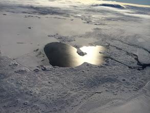 Photo: Sun reflecting from lake
