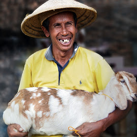 The Goat Seller by Erwin Rizaldi - People Professional People ( seller, market, strong, traditional, man, goat )