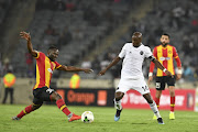 Musa Nyatama of Orlando Pirates and Franck Nom of Esperance during the CAF Champions League match between Orlando Pirates and Esperance at Orlando Stadium on February 02, 2019 in Johannesburg, South Africa.