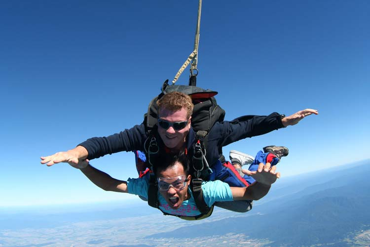 A visitor and instructor skydive over Cairns.