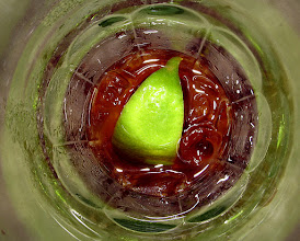 Photo: centered lime floating in beverage glass