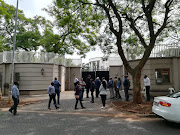 Officials from various government enforcement  agencies descended on the Gupta compound in Johannesburg on Monday, apparently as part of asset seizure operations.
