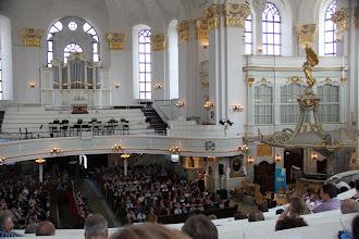 Photo: Inside the Michaelkirche, hundreds listen to a talk by ....