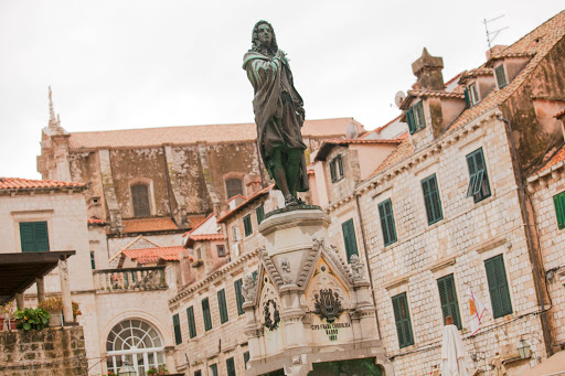 Old-Dubrovnik-statue.jpg -  Statue of Ivan Gundulic, a public figure of the 1600s, at the Gunduliceva poljana Market, Dubrovnik.