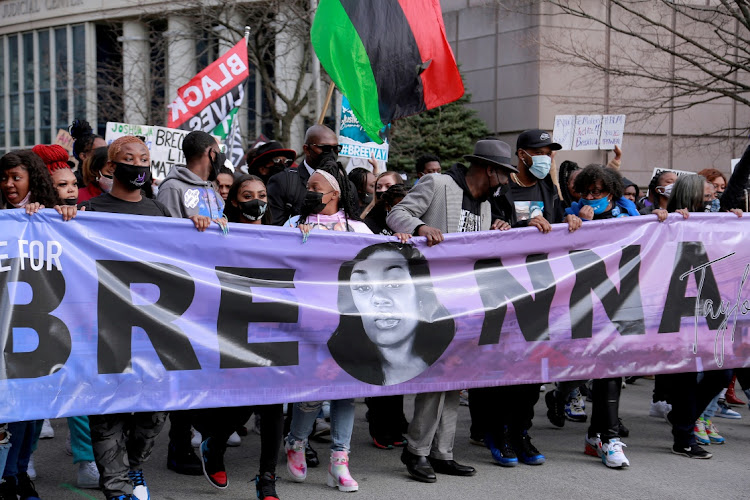People attend a rally to mark one year since police officers shot and killed Breonna Taylor when they entered her home, in Louisville, Kentucky, US on March 13 2021.