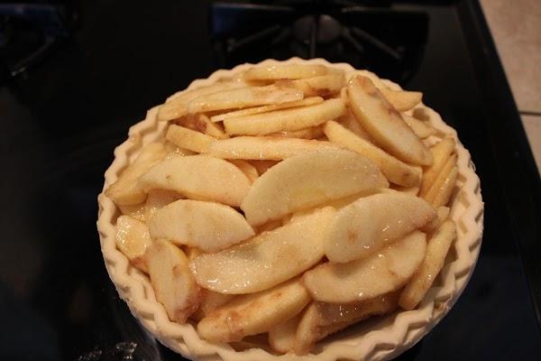 Put apple mixture into pie crust.