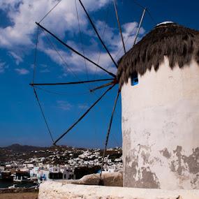Windmill looks down at town of Mykonos by Sandeep Kochar - Landscapes Travel ( mykonos, greece, sea, windmill, island )