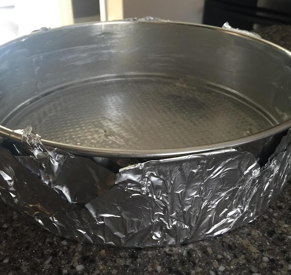 "Wrap a 10"" springform pan with two layers of heavy duty aluminum foil(only on..."
