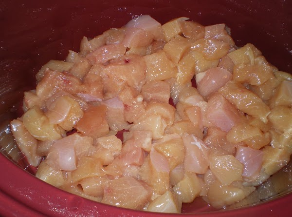 Cut chicken breast into bite size pieces and add to crock pot.