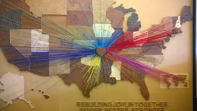 Photo: August 7-One of the displays in the Municipal Building showed where relief came from following the disastrous tornados in 2011.
