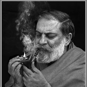Anees Haider Shah by Sami Ur Rahman - People Portraits of Men ( black & white, lighting pipe, close up, smoke, pipe smoker )