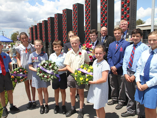 School captains and students were among the wreath layers at the Narrabri War Memorial. Above from left, Brock Gordon, Rosie Ross, Maeve Harris, Campbell Gourley, Tom Leitch, Poppy Penberthy, back, Georgia Goodhew and Layten Smith, St Mary's students Angus, Rory and Millie Taylor, rear, Narrabri RSL president Bruce O'Hara and Narrabri RSL sub branch president Gary Mason.