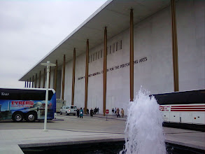 Photo: Lots of buses and fountains.