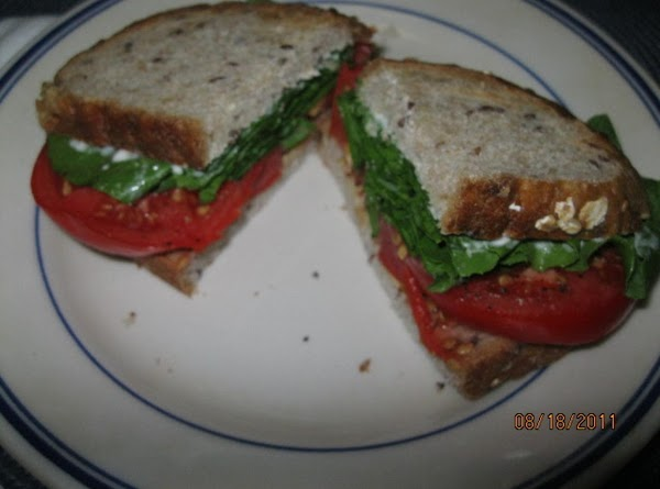 Slice the sandwich and put on a plate, pour a nice cup of something...