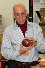 Photo: Mike shows his cedar potpourri holder.