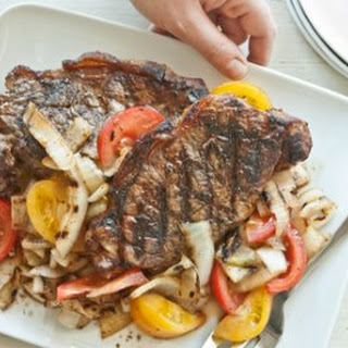 Grilled Strip Steaks with Spicy Onion and Tomato Salad.