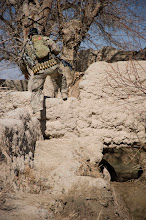 Photo: A U.S. Special Forces communications sergeant assigned to Special Operations Task Force – South steps carefully over an 18-inch-thick mud wall separating fields in the region while conducting a security patrol Feb. 20, 2011 in Panjwai District, Kandahar Province, Afghanistan. The SOTF-South Special Forces team in the area regularly patrols the area in order to bolster security as well as to meet with area villagers to assess development projects.    (U.S. Army photo by Sgt. Ben Watson)(Released).