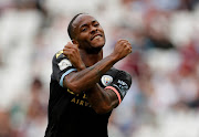 Manchester City's Raheem Sterling celebrates scoring their fifth goal and completing his hat-trick.