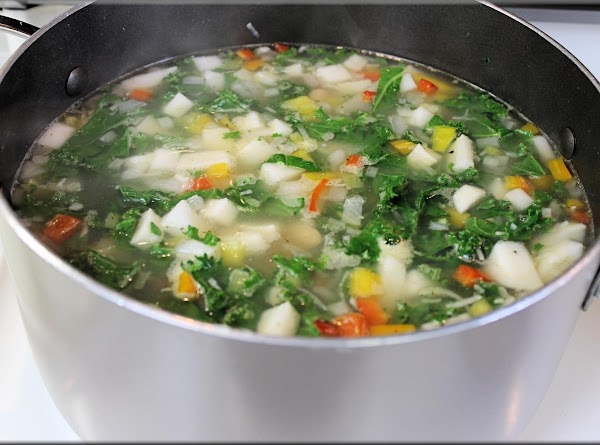 Add chicken broth and 1 cup of water to sauté onions and garlic. ...