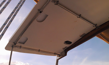 Photo: the access holes in the bimini allow for wiring and attachment points